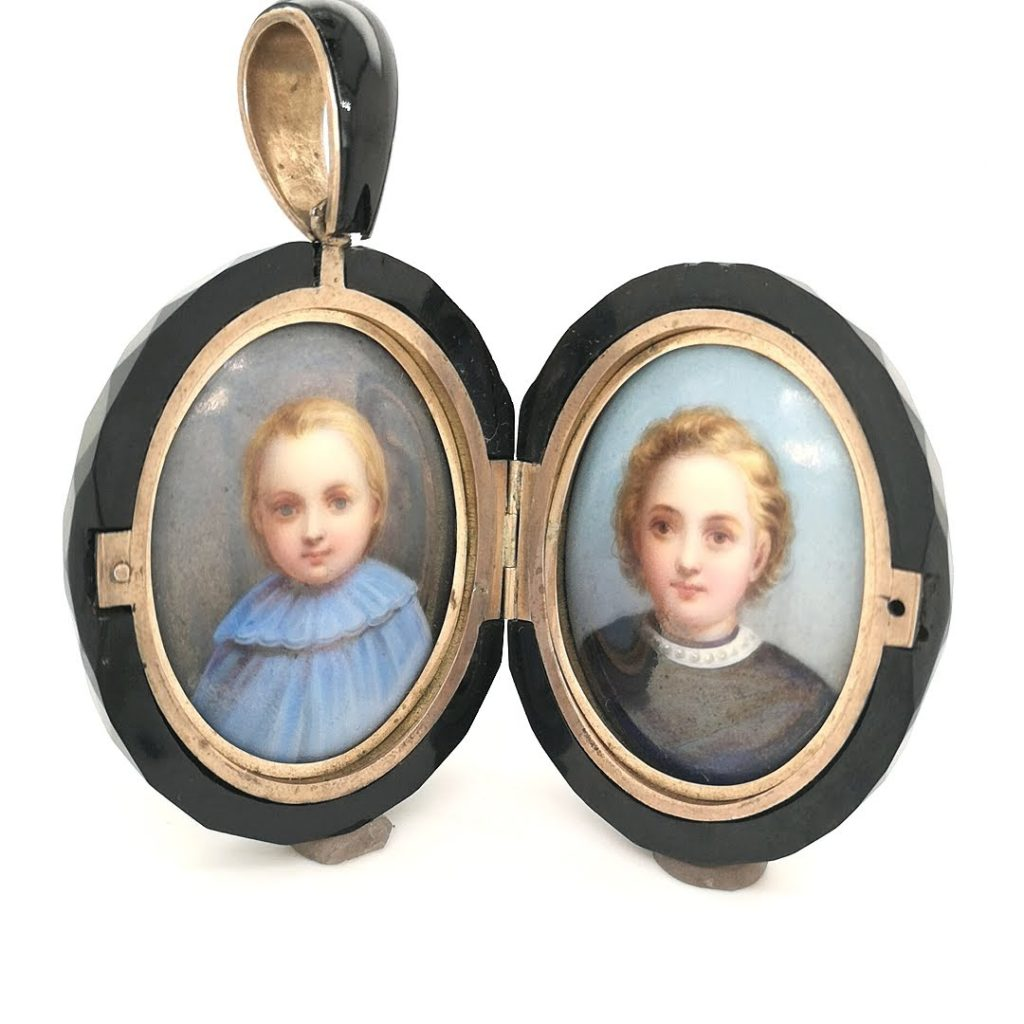 Whitby Jet locket with porcelain plaques